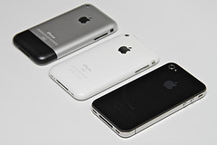 3 iPhones white background