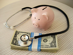 piggy bank, stethoscope, money