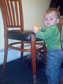 Blake standing with chair