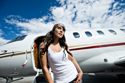 Affluent Travel - Beautiful Young Woman by Private Jet