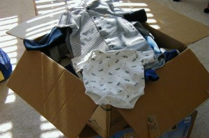 Box of baby clothes resized