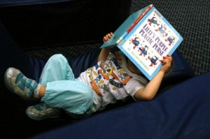 Toddler Reading a book resized