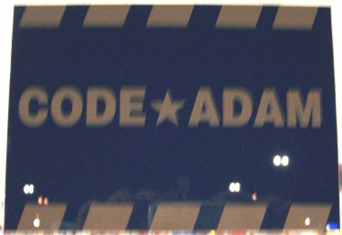 Code Adam logo on the front door of a Wal-Mart store.